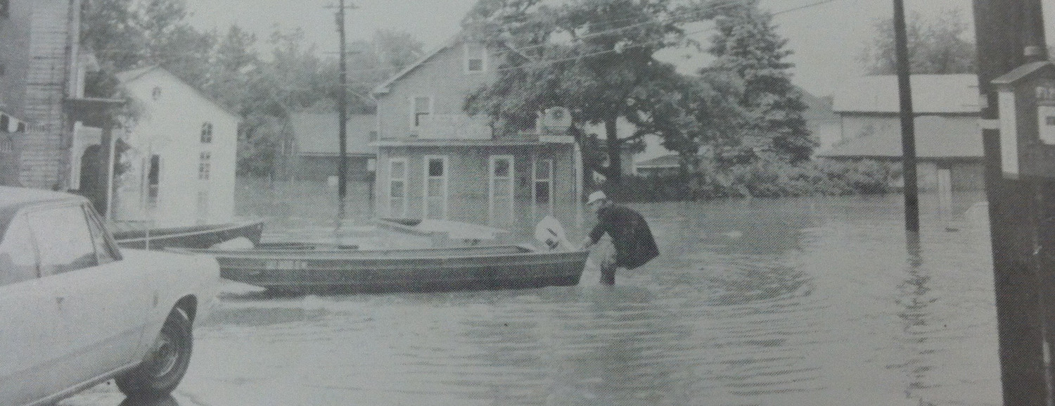 This photo shows The Milk Bar, the building in the center, as it appeared during the flooding from Tropical Storm Agnes in June, 1972. The photo is looking south from Ann and Union streets. The photo appears on page 12 of a book named Middletown Area Flood June 1972, a collection of photos that was published by Robert Forsythe and Harold Hickernell. The book can be found in the Middletown Public Library.