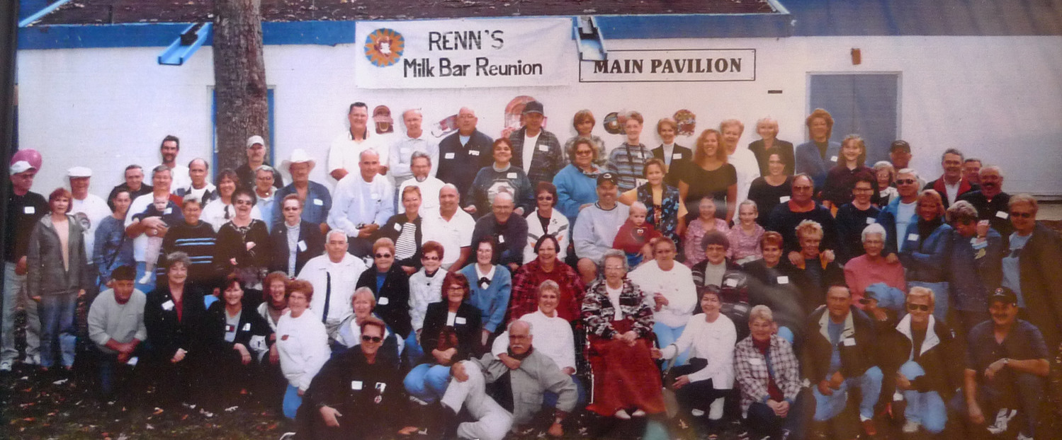 This is the photo from the first Milk Bar reunion at Hoffer Park in October 2002. Esther Renn is pictured in the center front, with the red blanket on her legs.