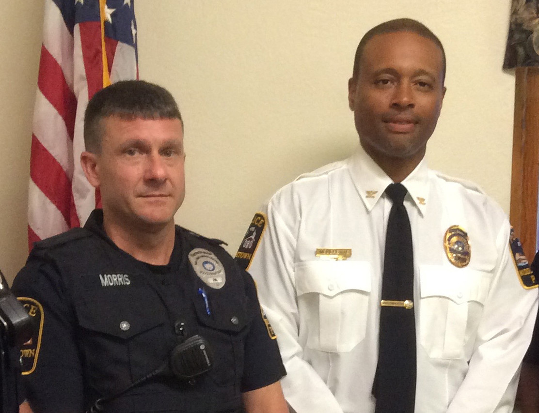 Sgt. Dennis Morris, left, is seen in this August 2017 photo with Middletown Police Chief George Mouchette.