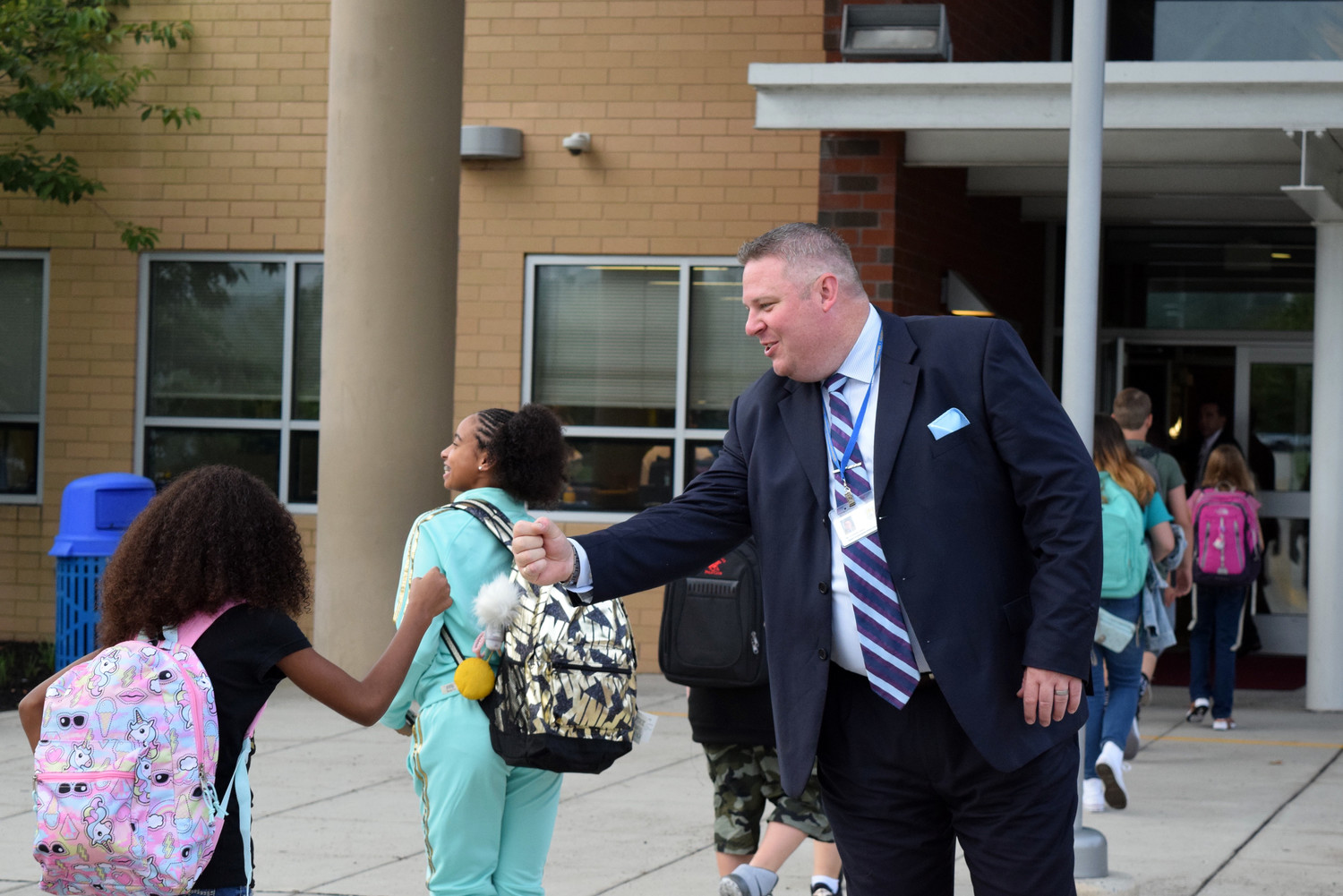 Chris Sattele, Middletown Area Middle School assistant principal, greets students as they enter MAMS on Monday