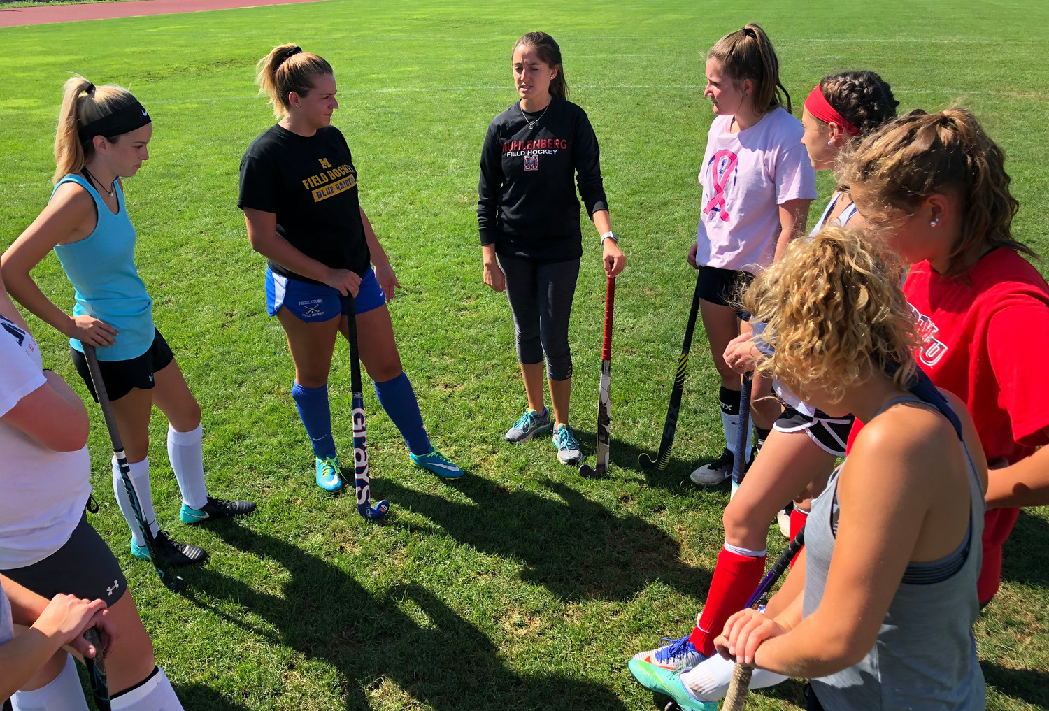 Players listen to coach Sierra Lenker.