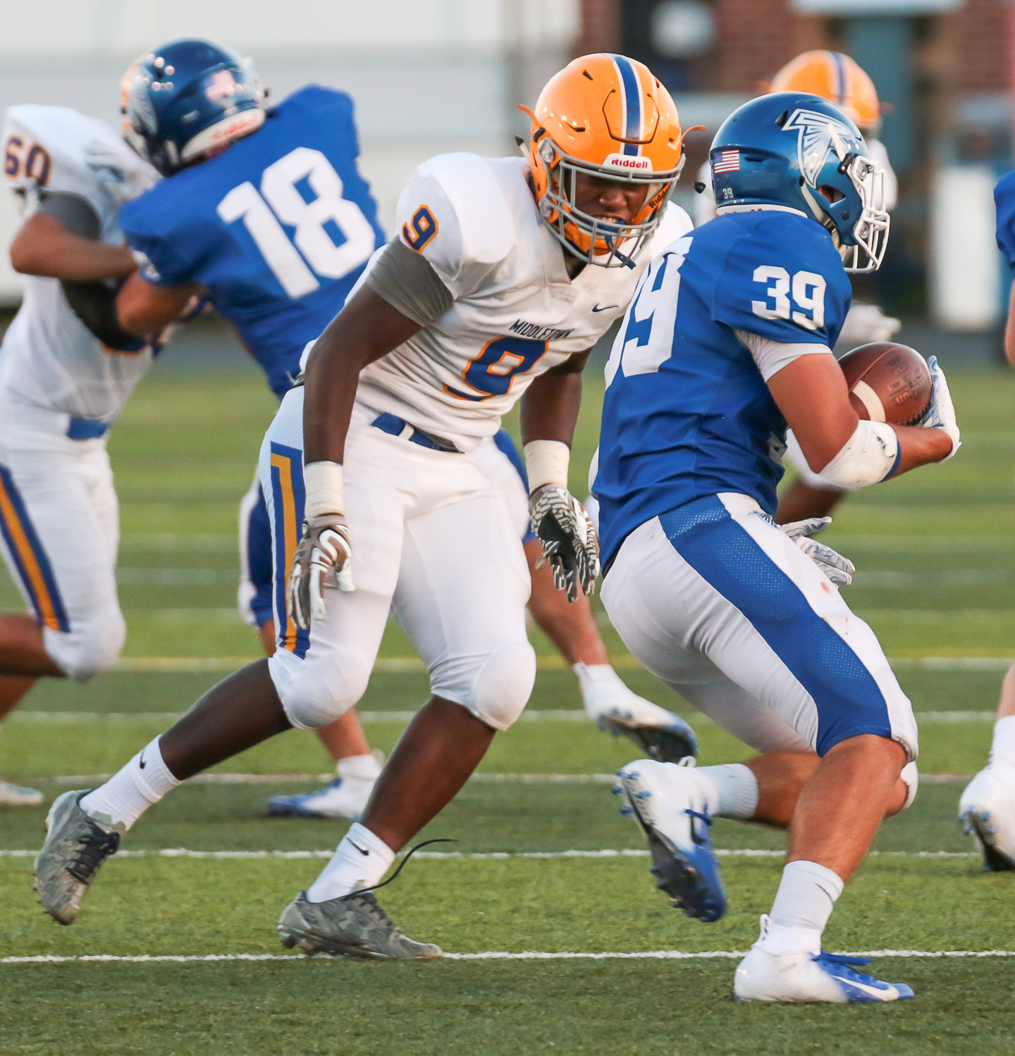 Middletown defensive end Adonis Taveras bears down on Lower Dauphin running back Isaac Buck.