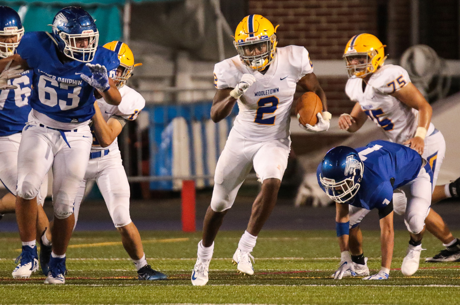 Blue Raider running back Richie Sykes busts through the Lower Dauphin defensive line.