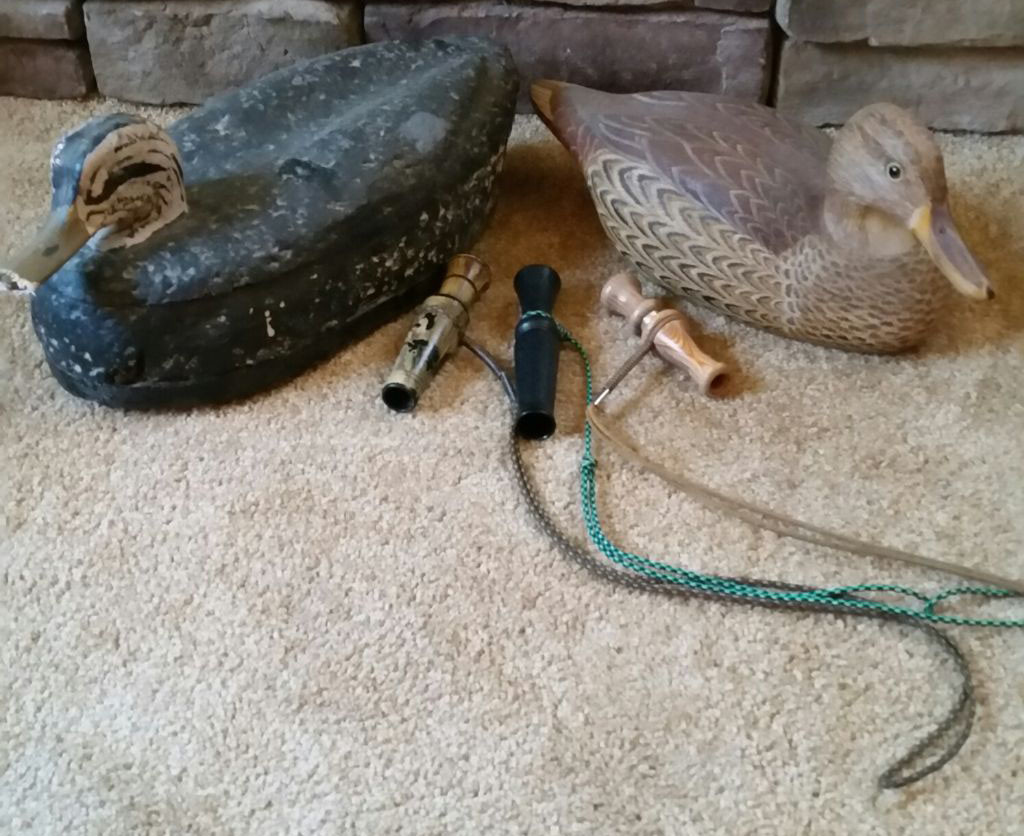 "The group of duck calls was given to Tom Shank from Mrs. John Barnes. The wooden mallard hen decoy was given to him many years ago from James ""Ginny"" Gallagher. The cork black duck was given to Shank by Tim Taylor. ""The above items are priceless to me and are a remembrance of a true mentor,"" Shank said."