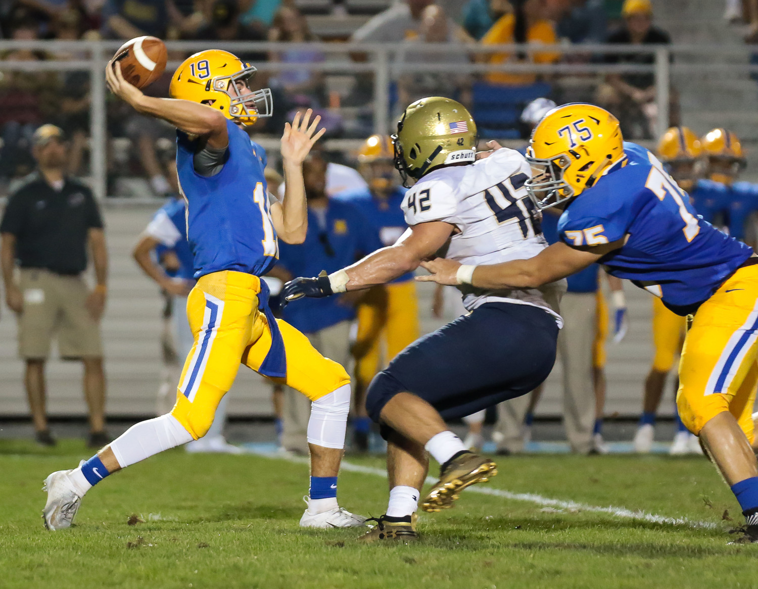 Scott Ash fires a pass for the Blue Raiders in Friday's 40-14 loss to Bishop McDevitt at War Memorial Field. No. 75 Morgan Billman does the blocking.