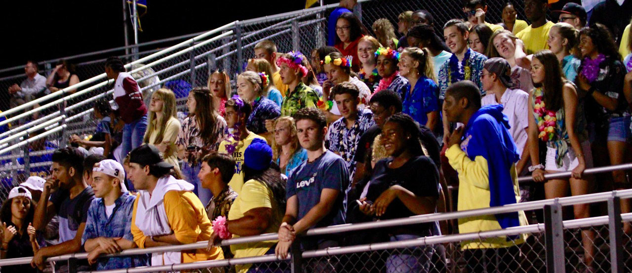 The crowd roots on the Blue Raiders during Friday's 40-14 loss to Bishop McDevitt at War Memorial Field.