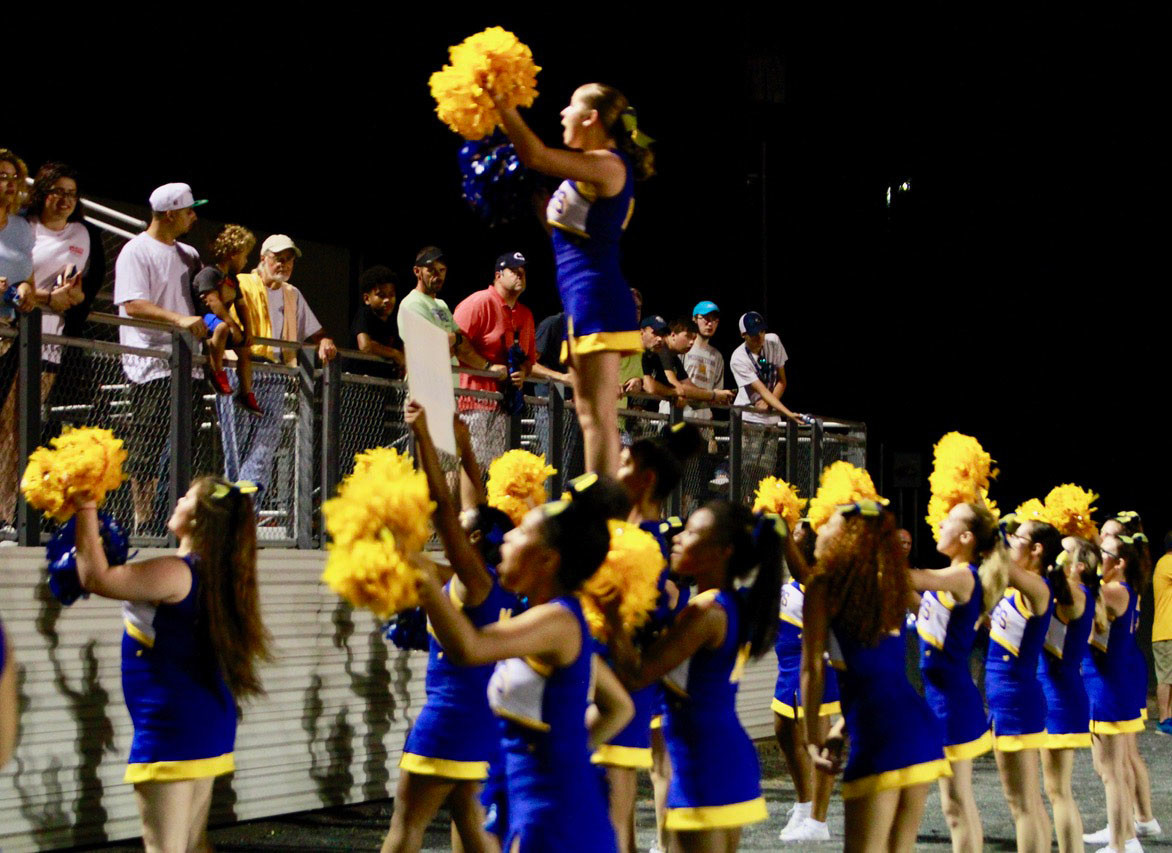 Blue Raider cheerleaders try to fire up the crowd during Friday's 40-14 loss to Bishop McDevitt at War Memorial Field.