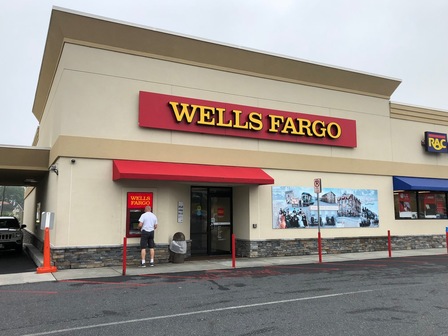A customer uses the ATM at Wells Fargo on West Main Street on Wednesday morning, a day after an attempted bank robbery there.