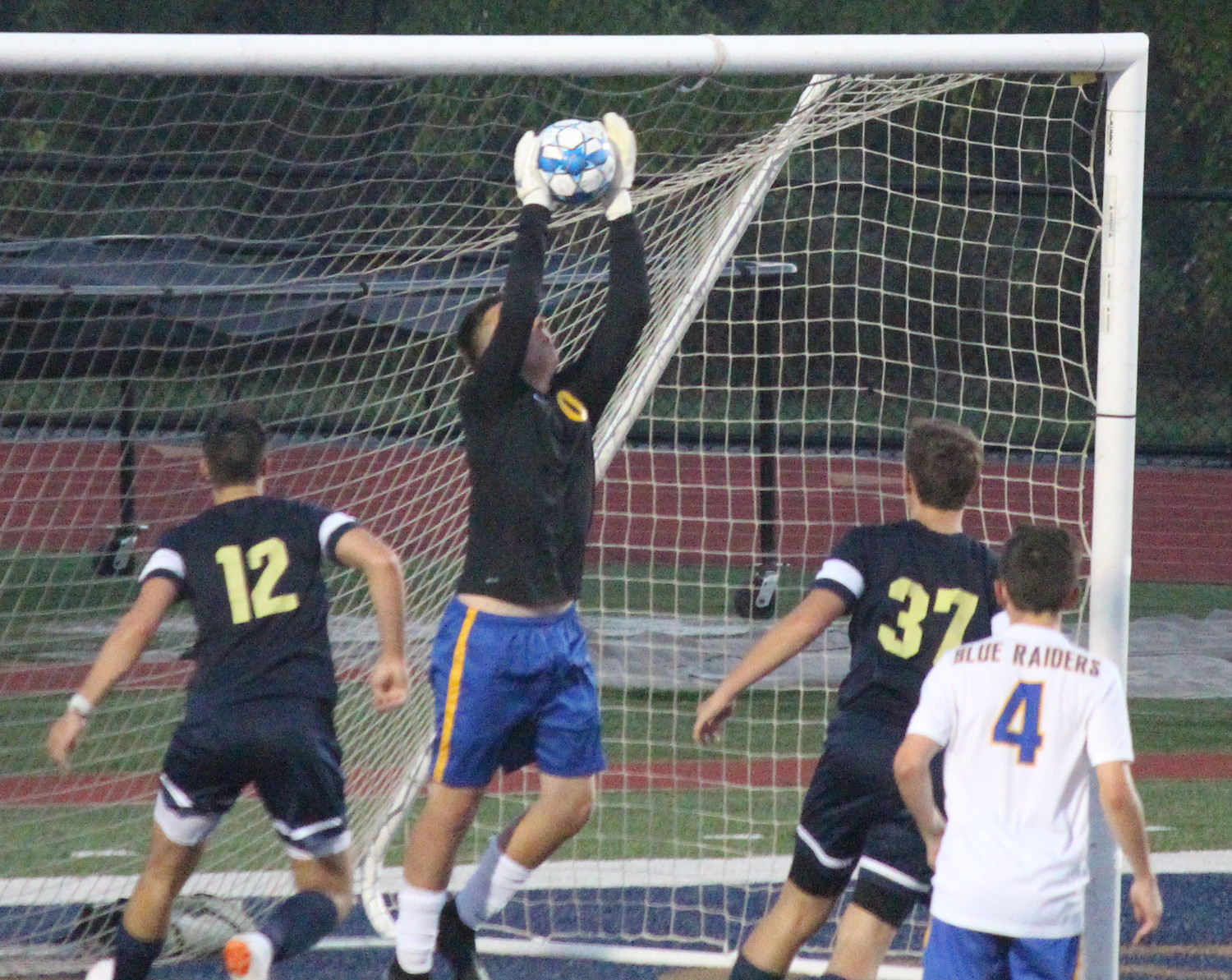 Caleb Springer makes one of his 11 saves Sept. 4 at Bishop McDevitt.