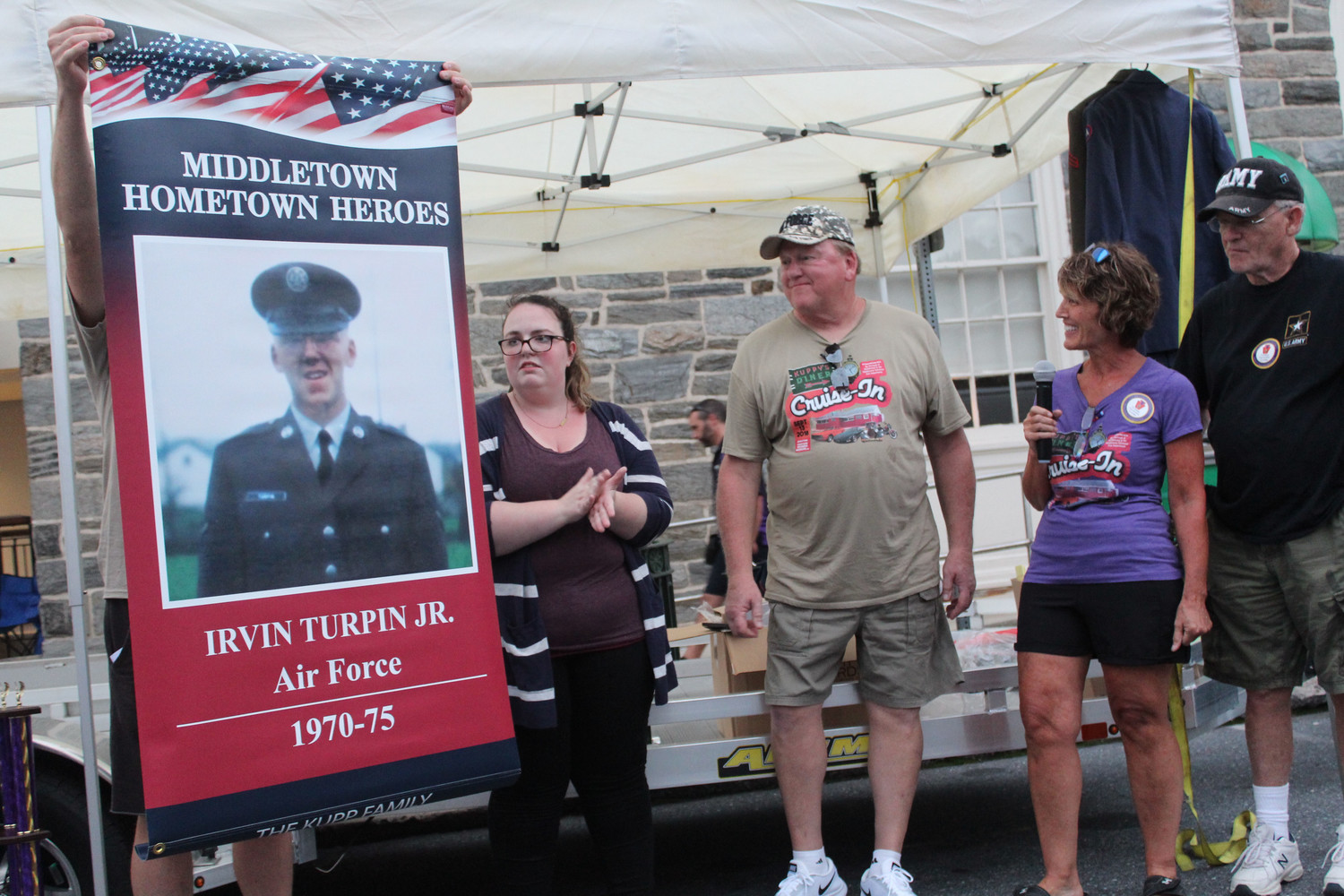The Kupps had a Middletown Hometown Heroes banner made for Air Force Veteran Irvin Turpin Jr. (center). The banner was unveiled during Kuppy's Diner Cruise-in on September 13.