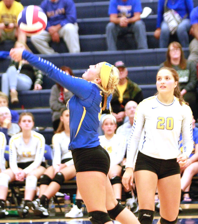 Hannah Wilsbach returns a ball over the net in September while Courtney Shaffer watches during Middletown's loss to West Perry in late September.