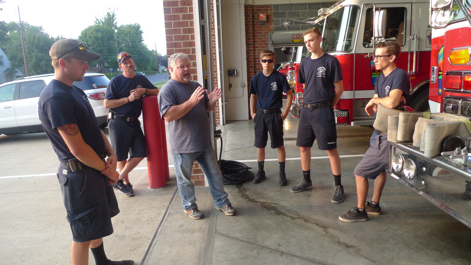Middletown Fire Marshal Mick Shrauder (gesturing, third from left), prepares the live-ins and other firefighters before going to Frey Village to observe and evaluate a fire drill. From left is Zach Cleland, Lieutenant Daryl Tripp, Shrauder, Christian Slesser, Storm Fickes, and Kody Krupilis.