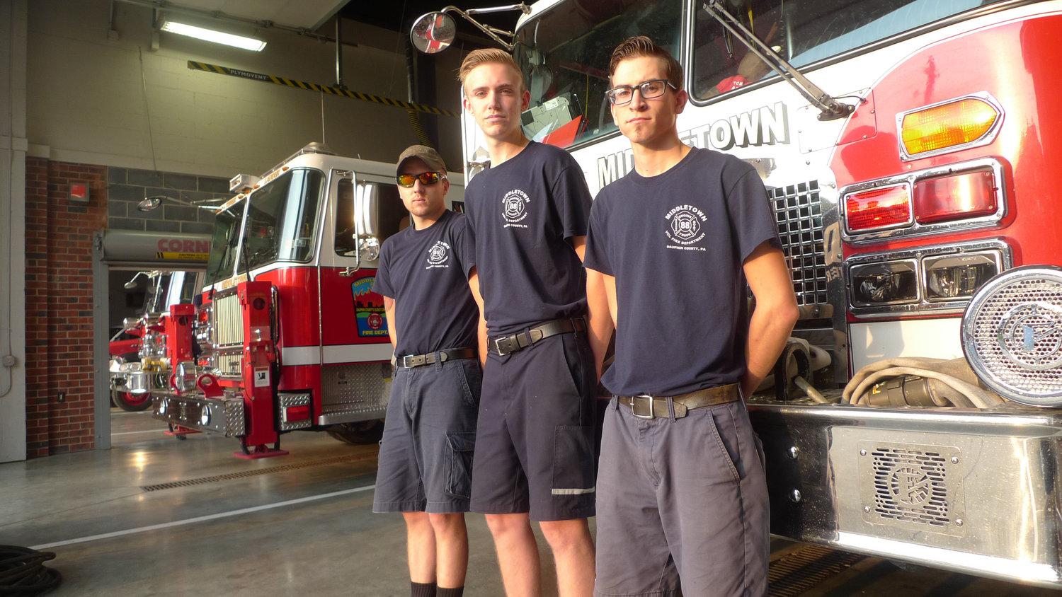 "Middletown Volunteer Fire Company's three ""live-ins"" pose inside their home in the fire station on Adelia Street. From left are Zach Cleland, Storm Fickes, and Kody Krupilis."
