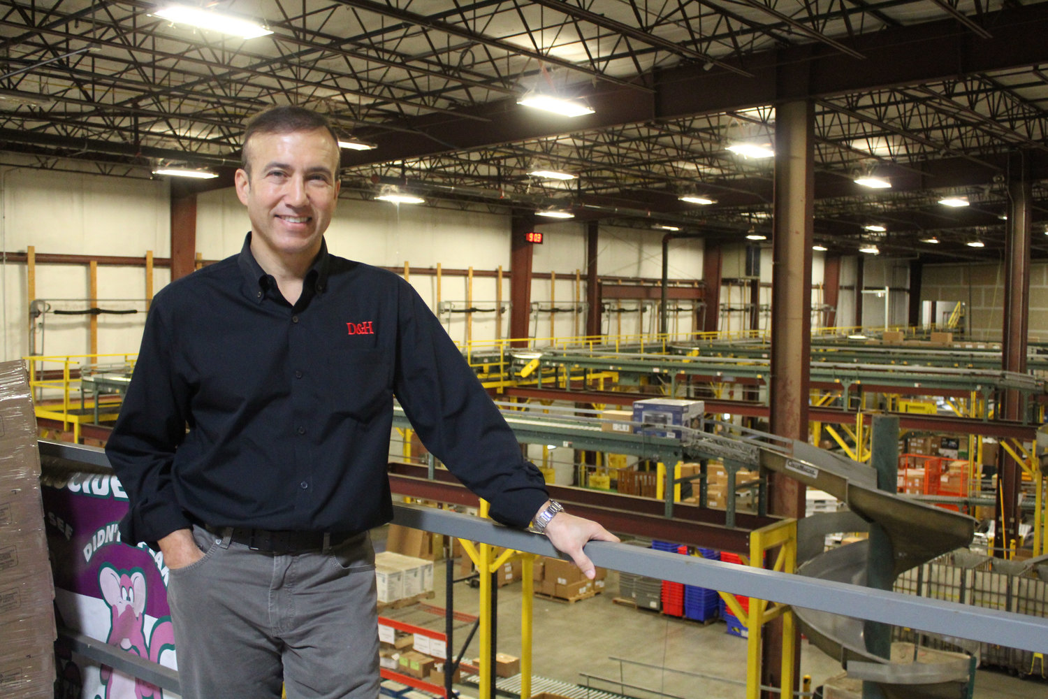 Michael Schwab, Co-President of D&H Distributing, stands in the company's distribution hub in Harrisburg. The company plans to build a new hub on the Jednota site in Lower Swatara.