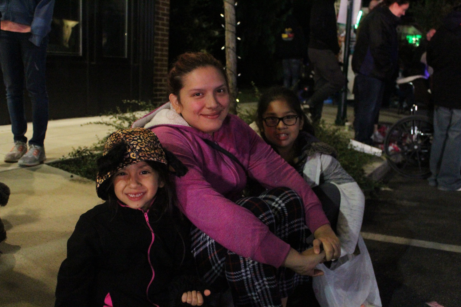 Jeylin Hernandez, Karem Sanchez and Leslie Sarmiento watch the Halloween parade on Oct. 16.