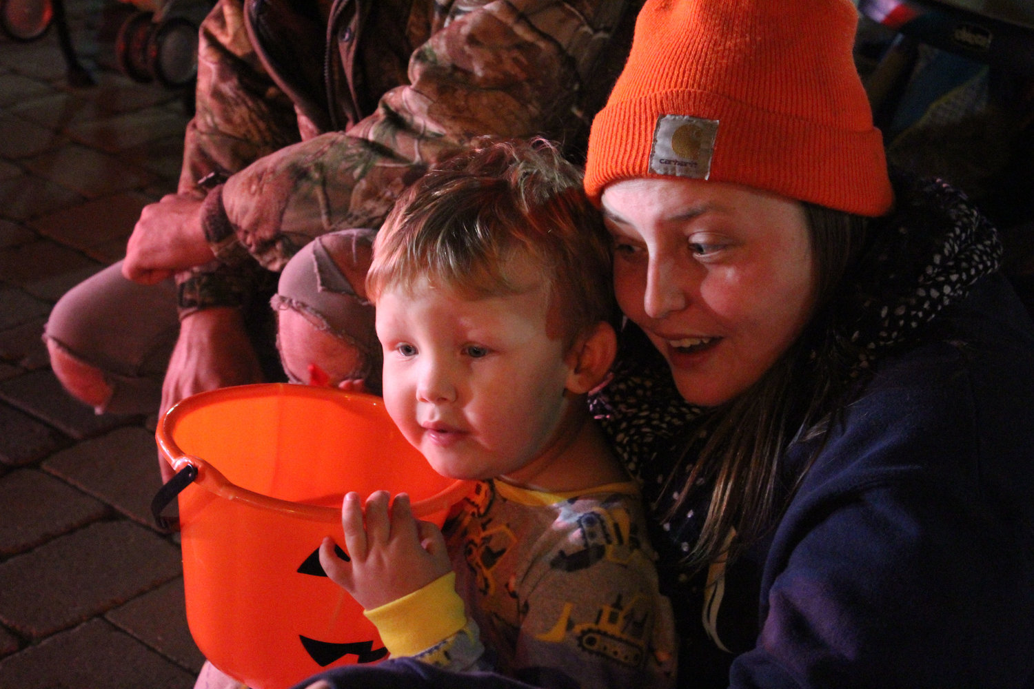 Landon Miller and Danielle Henry wait for candy during the Halloween parade on Oct. 16.
