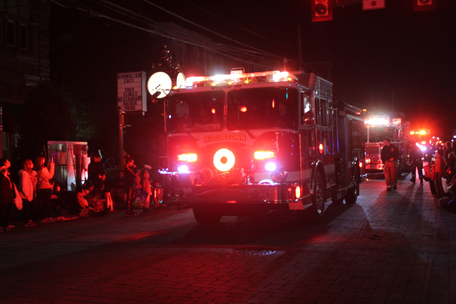 A Middletown firetruck drives down North Union Street during the Halloween parade on Oct. 16.