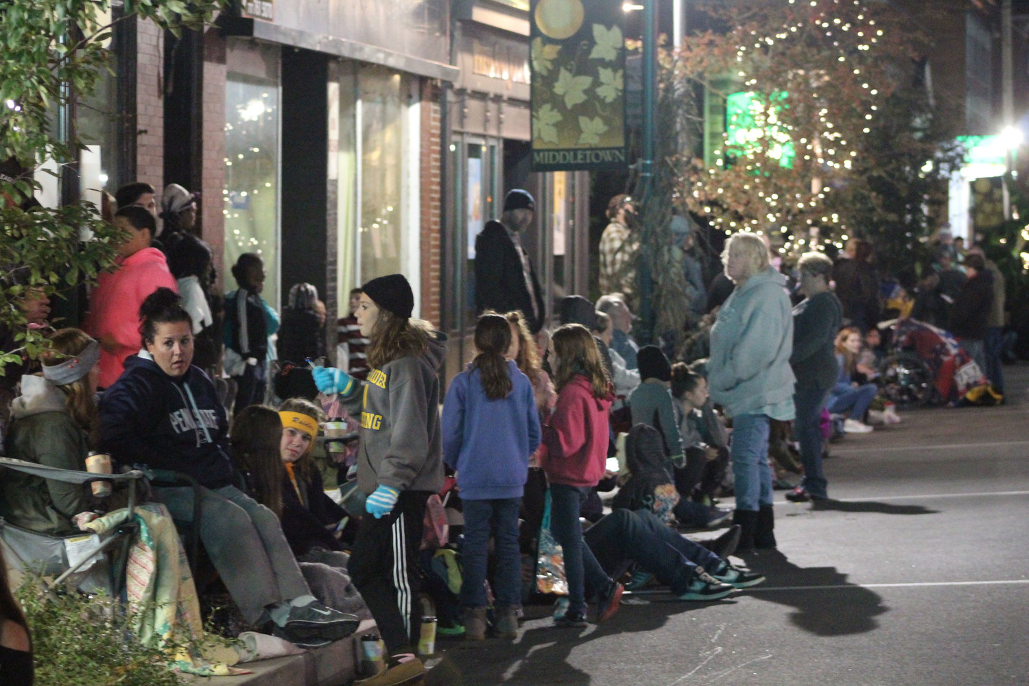 People grab seats along North Union Street and wait for the Halloween parade on Oct. 16.