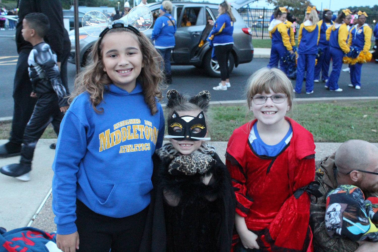 Riley Brown, Ellee Shearer and Frankee Shearer wait for the Halloween parade to start on October 16.