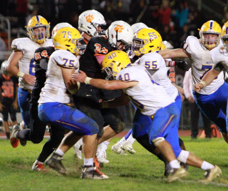 The Raider defense swarms Oct. 19 vs. East Pennsboro.