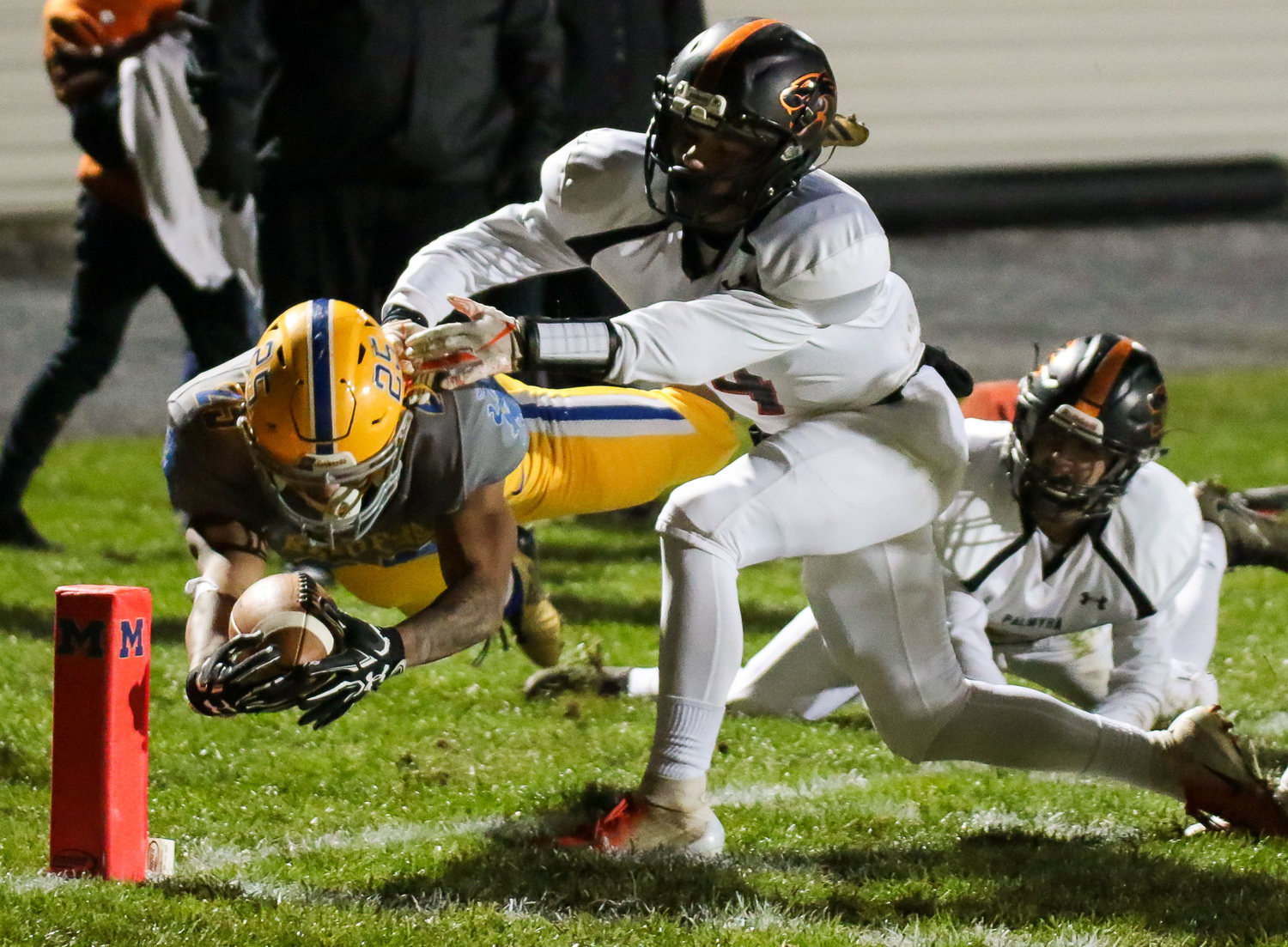 Jose Lopez dives for the end zone Oct. 26 against Palmyra at War Memorial Field.