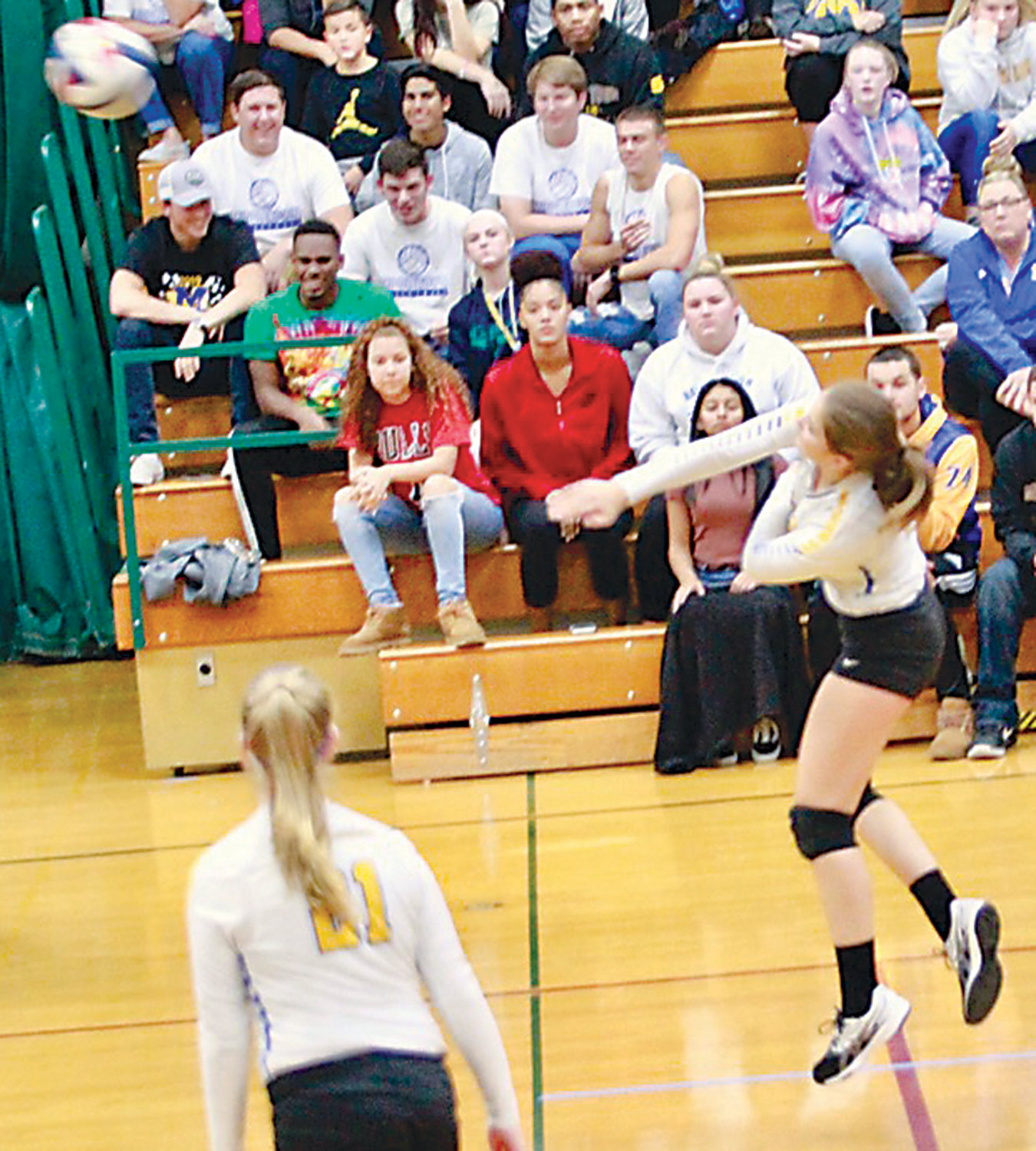 Courtney Shaffer drives the ball over the net during Middletown's district matchup with York Catholic on Oct. 30.