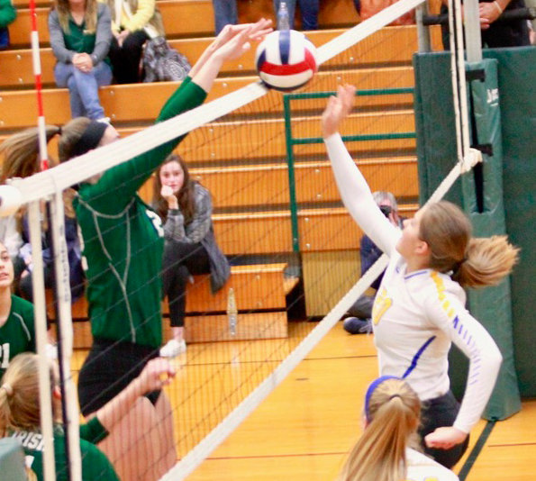 Kendall Stiffler tips the ball over the net during Middletown's district matchup with York Catholic on Oct. 30.