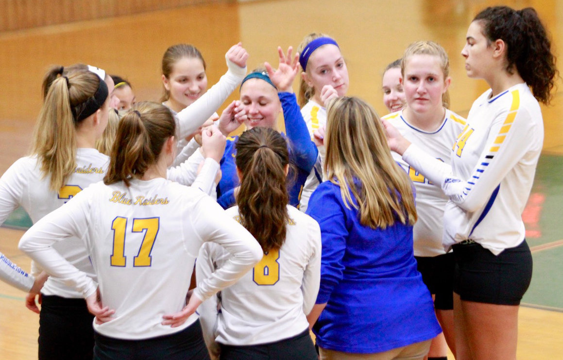 The Middletown volleyball team huddles during its district matchup with York Catholic on Oct. 30.
