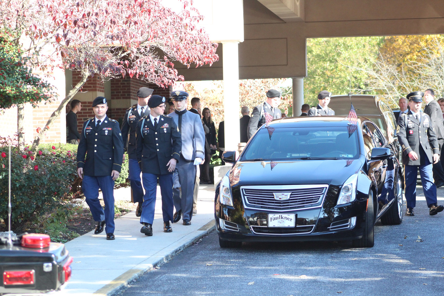 Soldiers walk out of Seven Sorrows of the Blessed Virgin Mary Catholic Church in Middletown following the funeral of Spc. Mason James Guckavan on Nov. 8.