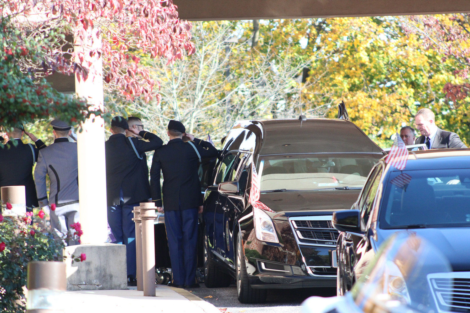 Soldiers salute as the casket is loaded into the hearse following Spc. Mason James Guckavan's funeral on Nov. 8 at Seven Sorrows of the Blessed Virgin Mary Catholic Church in Middletown.