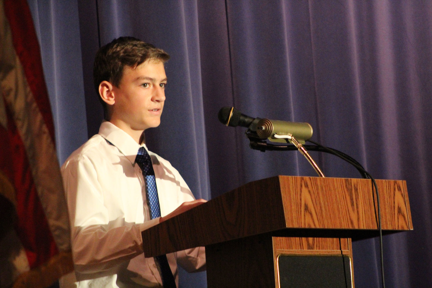 Eighth-grader Jaron Imler reads his speech during MAMS Veterans Day Program Nov. 9.
