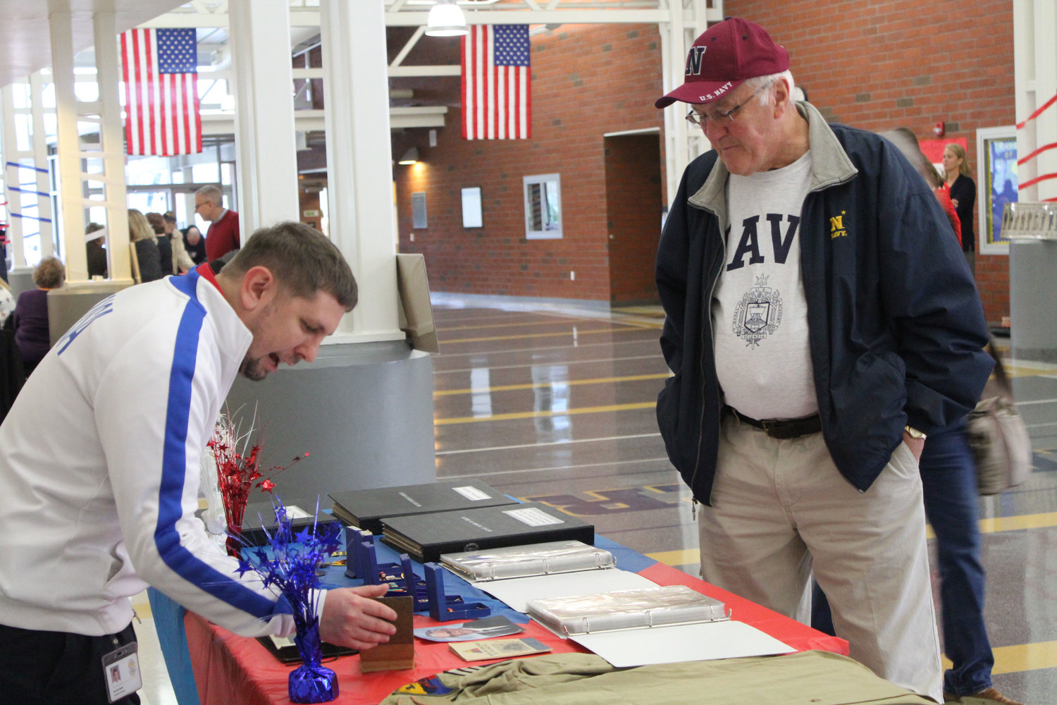 Harold Pomraning looks at Zach Kepler's display at MAMS on Nov. 9 of his great-uncle's medals, letters, uniforms and pictures from his time in the service.