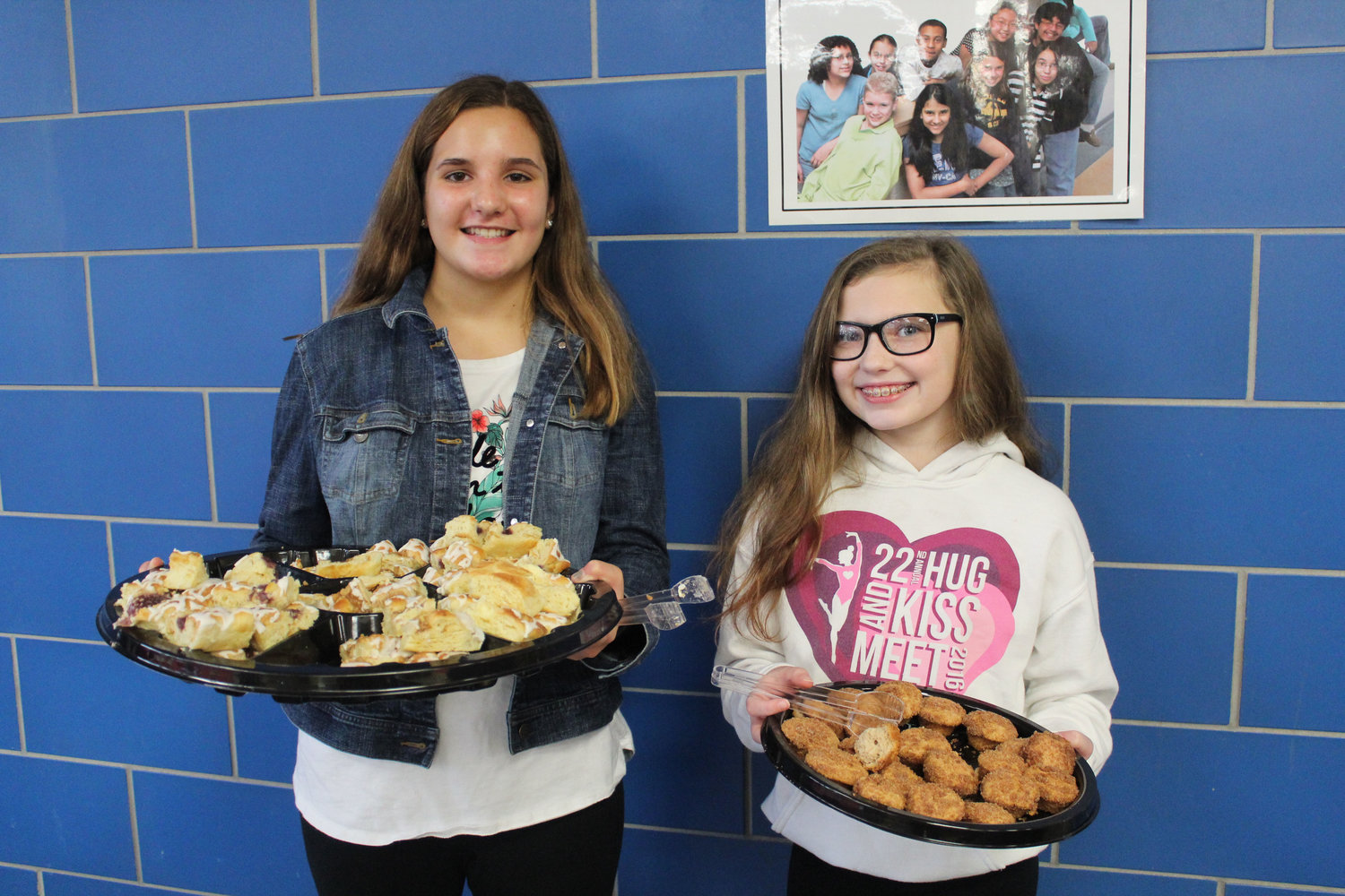 Morgan Judy and Claire Munnelly serve breakfast during the Veterans Day Program at MAMS Nov. 9.