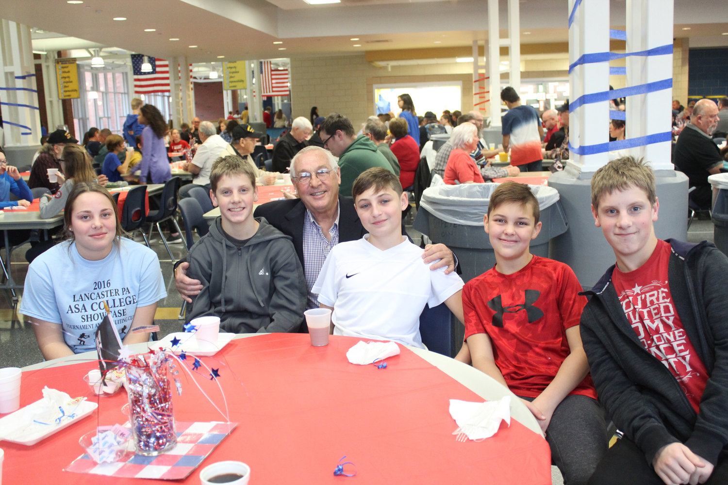 Christine Miller, Geno Corradi, Mario Corradi, Dominic Corradi, Adrian Corradi and Enzo Corradi eat breakfast at MAMS as part of the Veterans Day Program Nov. 9.