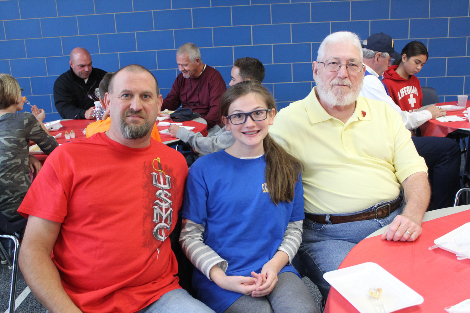 Scot Brown, Madison Brown and Alan Leedom eat breakfast at MAMS as part of the Veterans Day program Nov. 9.