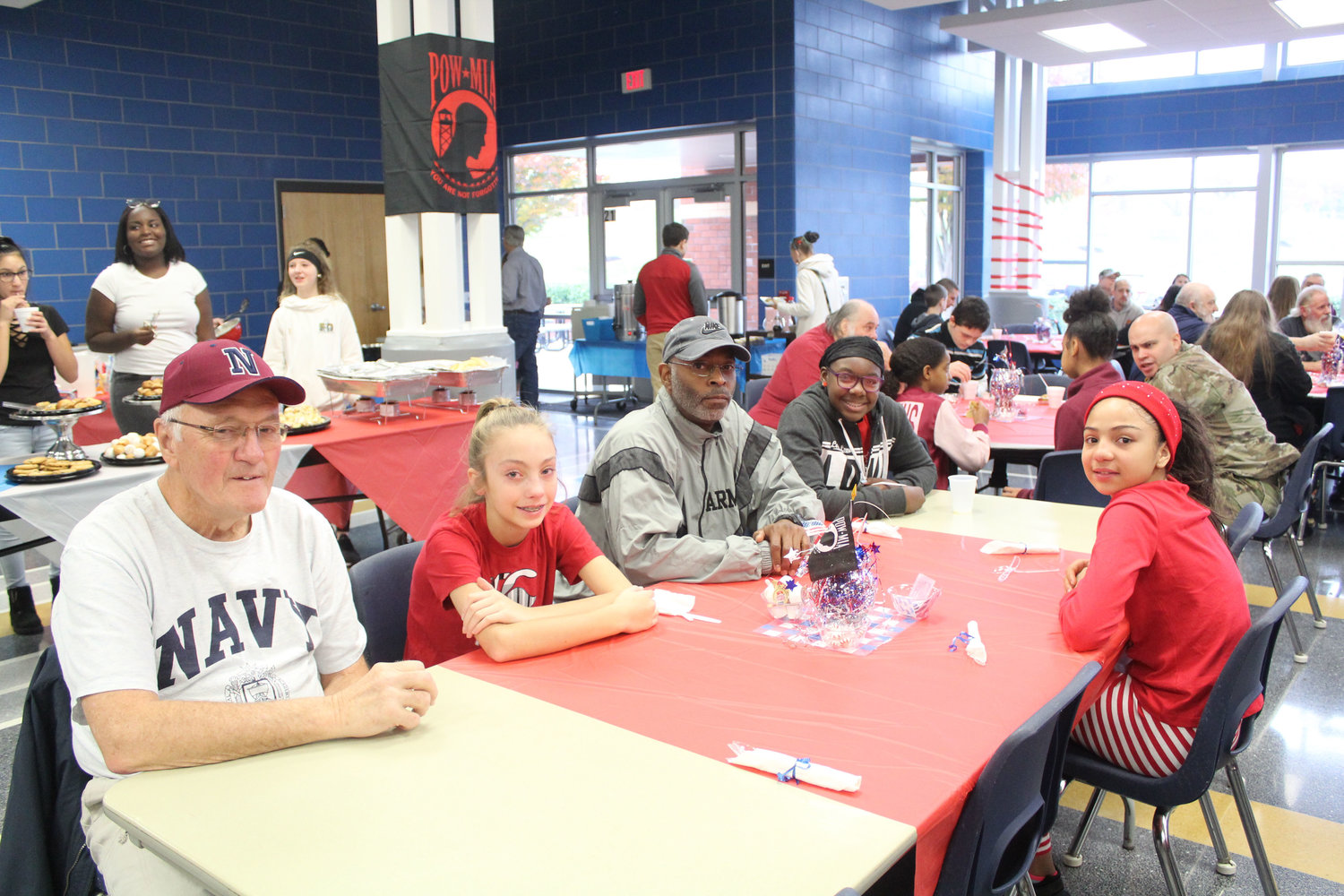 Harold Pomraning, Cassidy Pomraning, Wayne V. Cooley Sr., Peyton Chisholm and Heidy Castillo eat breakfast at MAMS as part of the Veterans Day program on Nov. 9.