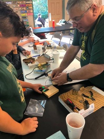 8270: Scout Master Tom D'Auria teaches Xavier Derr about circuit boards.