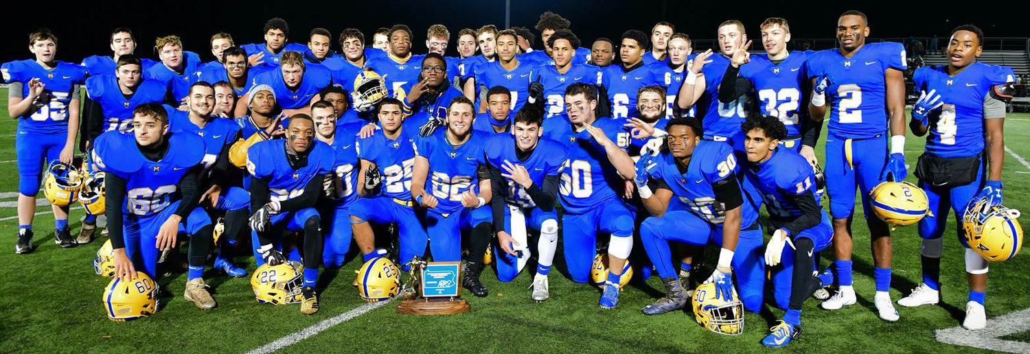 The Middletown Blue Raiders celebrate after Nov. 16's 42-20 win vs. Bermudian Springs for the district title.