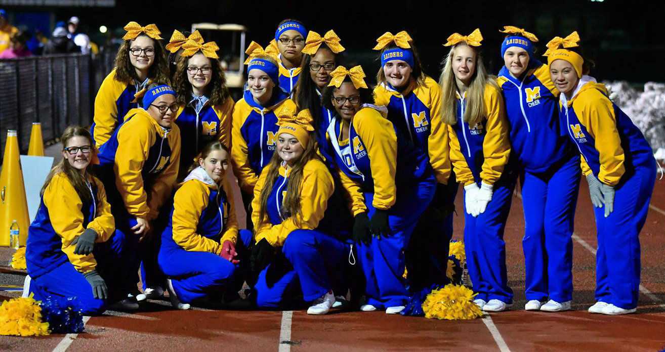 The Middletown cheerleaders pose during Nov. 16's 42-20 win vs. Bermudian Springs for the district title.