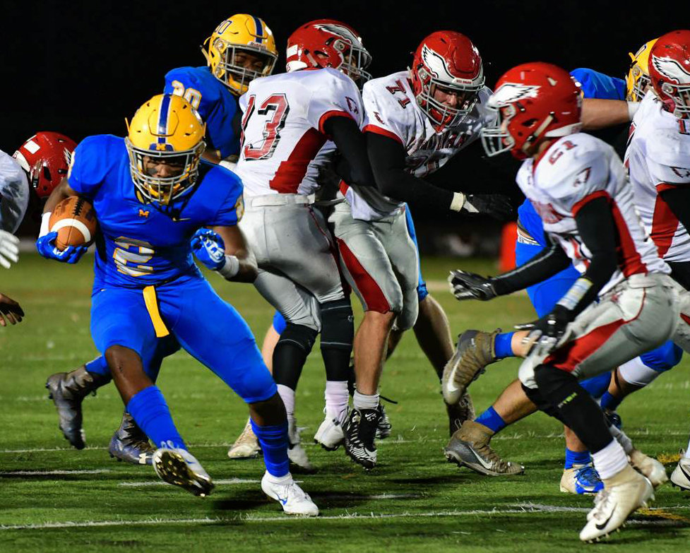 Richie Sykes looks to get past a Bermudian Springs defender in Nov. 16's 42-20 win for the district title.