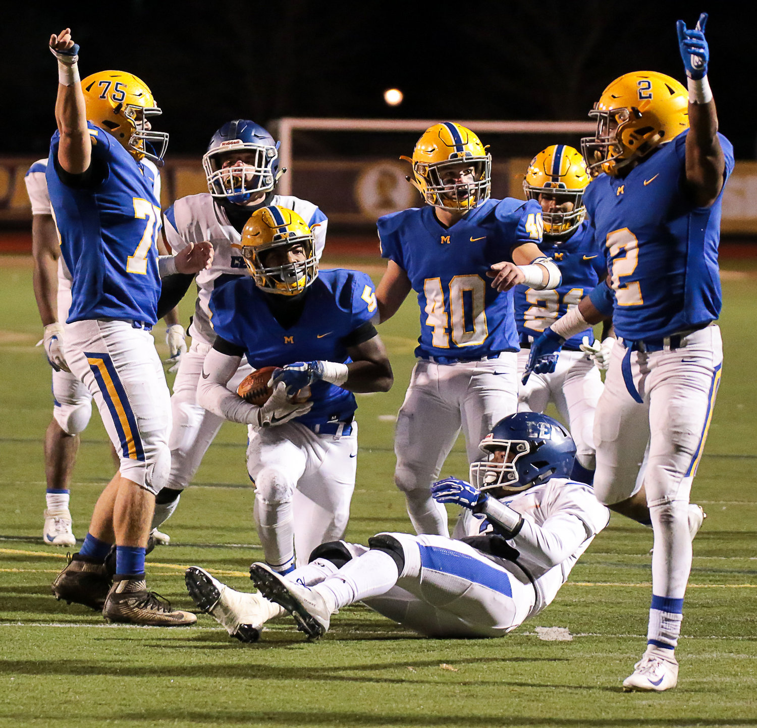 Morgan Billman (No. 75), Gage Radabaugh (No. 40) and Richie Sykes (No. 2) celebrate a fumble recovery by Trayvon Joseph (No. 5, with the ball) in the third quarter of Middletown's 21-14 win over Conwell-Egan at Milton Hershey High School in the PIAA 3A state quarterfinals Nov. 23.