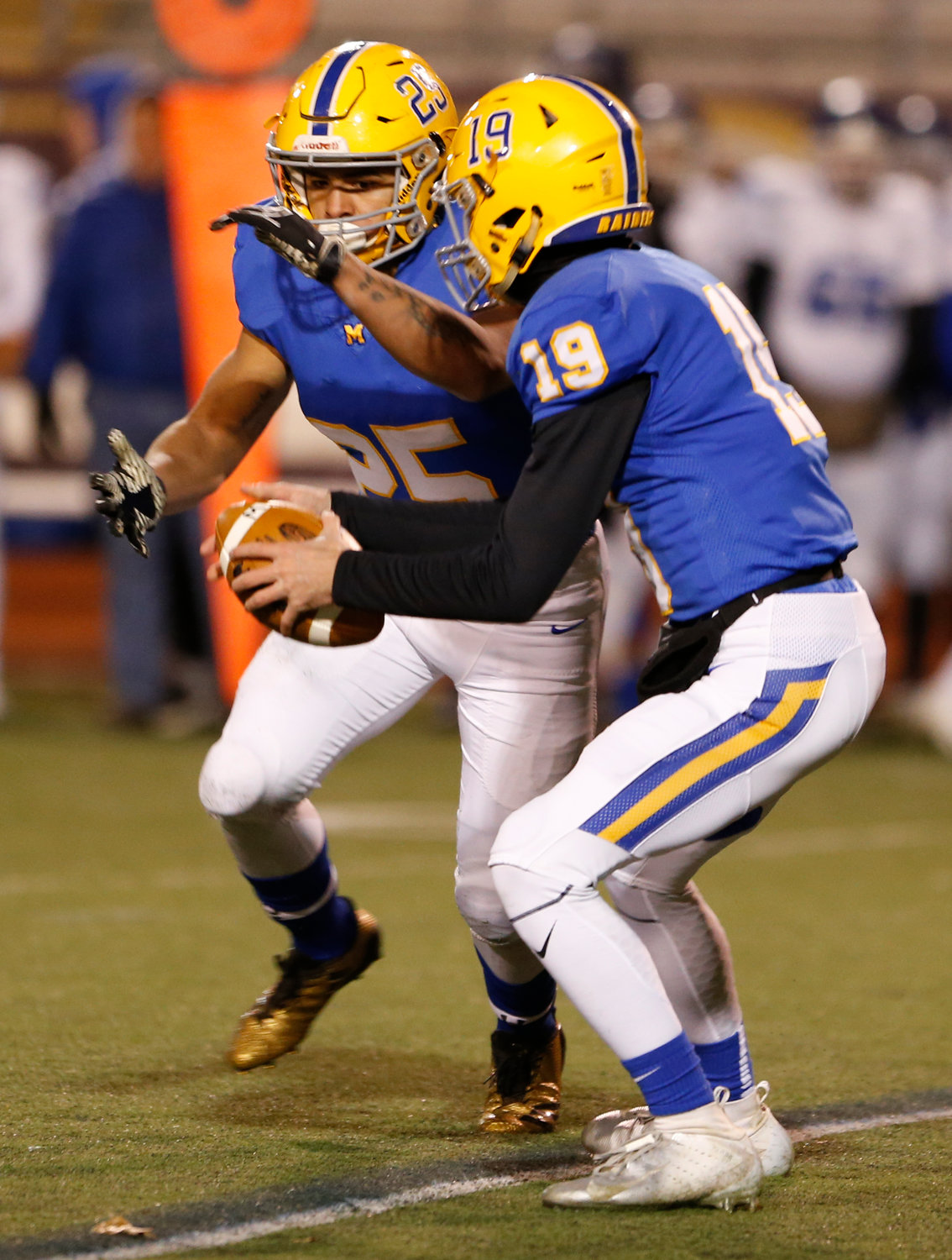 Scott Ash hands off the ball to Jose Lopez during Middletown's 21-14 win over Conwell-Egan at Milton Hershey High School in the PIAA 3A state quarterfinals Nov. 23.