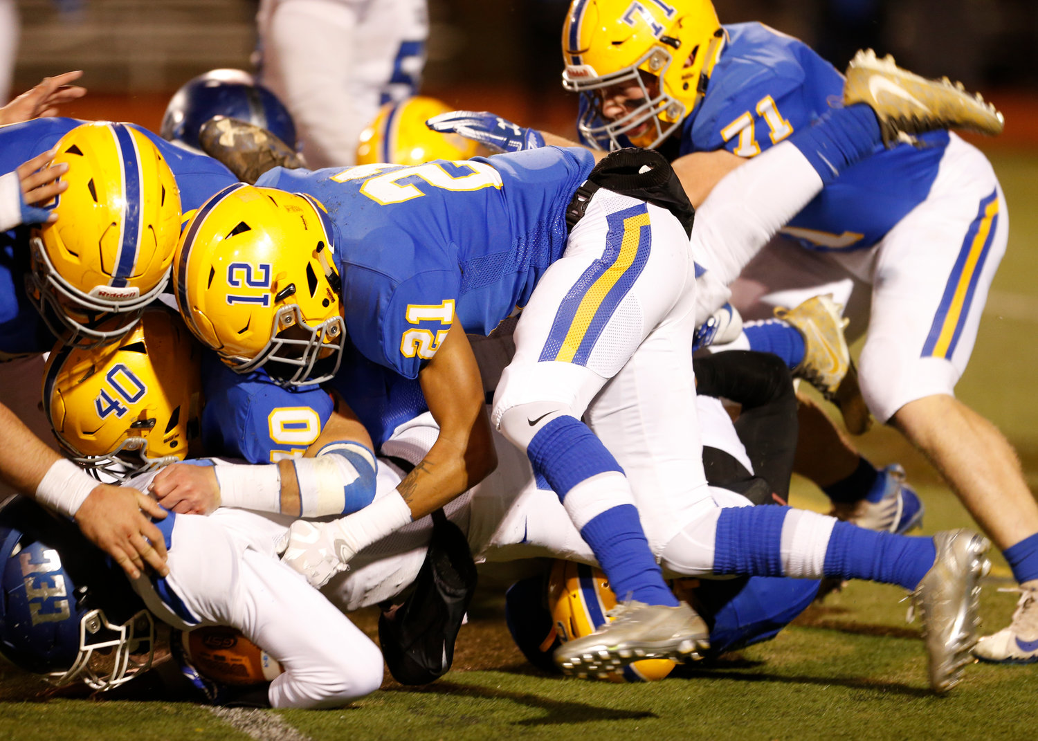 Joe Gusler, top left, Gage Radabaugh (No. 40), Antonio Bryant (No. 21) and Ethan Miller (No. 71) take down the ball carrier during Middletown's 21-14 win over Conwell-Egan at Milton Hershey High School in the PIAA 3A state quarterfinals Nov. 23.