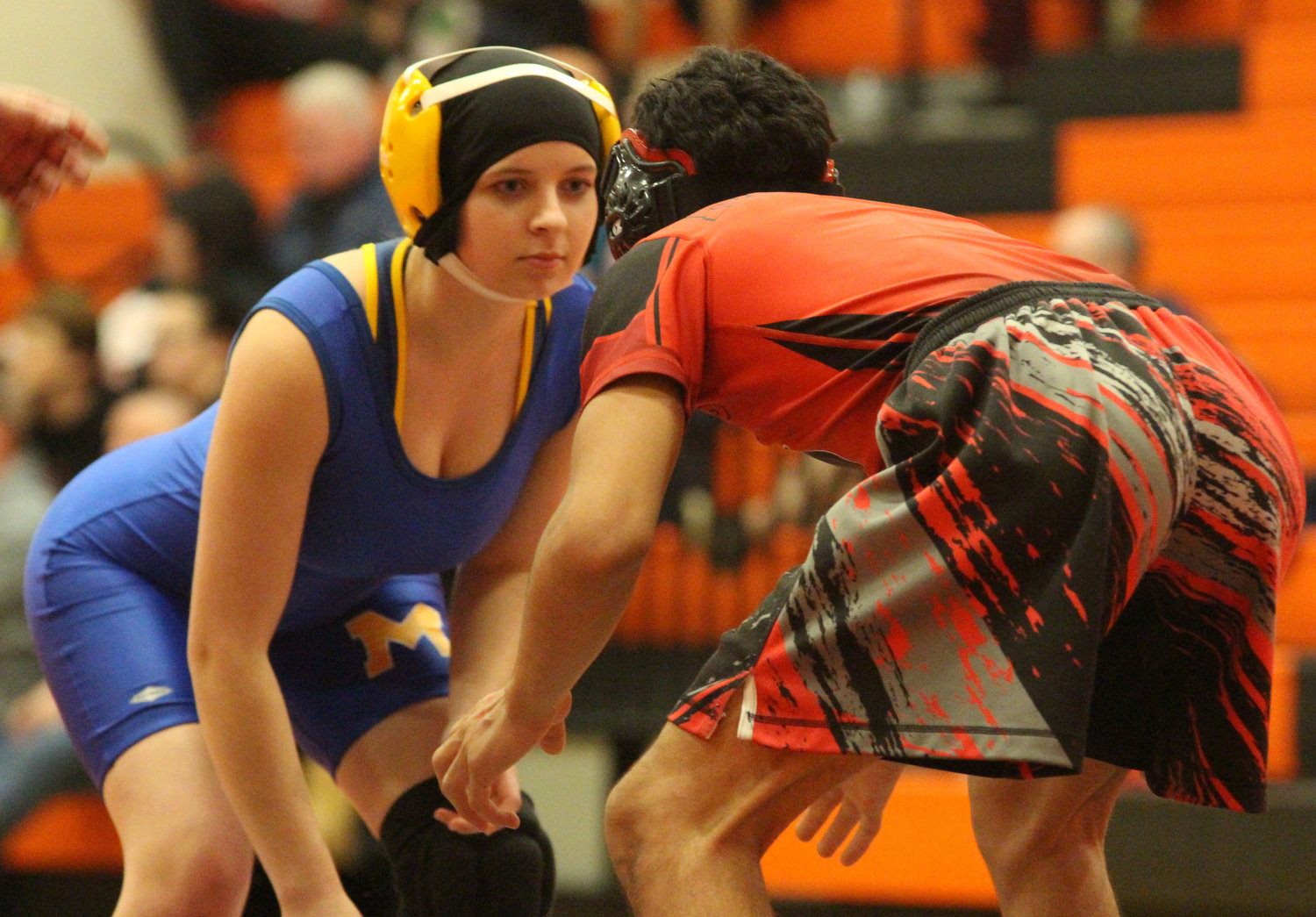 Krea Scheaffer earned her first varsity wrestling win by forfeit at 106 pounds vs. York Suburban on Saturday. Here, she takes on her Reading opponent. She is the first female to wrestle in a Middletown varsity match.