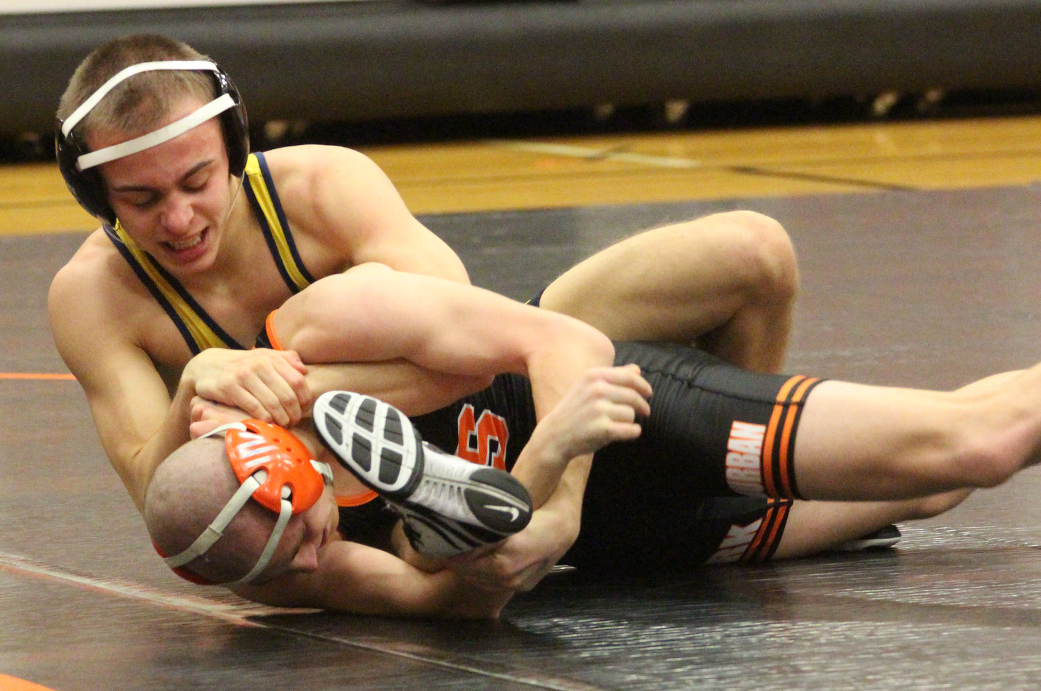 Nate Brady works his York Suburban opponent Saturday in the Snacktown Duals in Hanover.