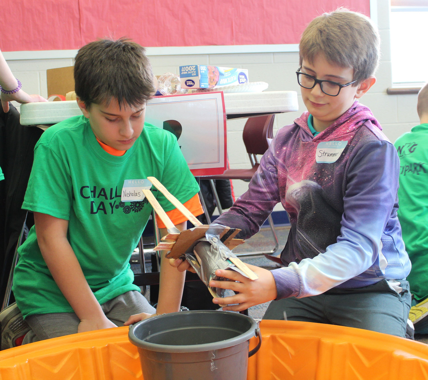Palmyra's Nicholas Campisano builds a tower with Middletown student Strummer Woodworth during the Challenge Day on Nov. 29. Students in gifted programs from four area school districts were challenged to focus on foundation and build a tower that could withstand wind, an earthquake and weight.