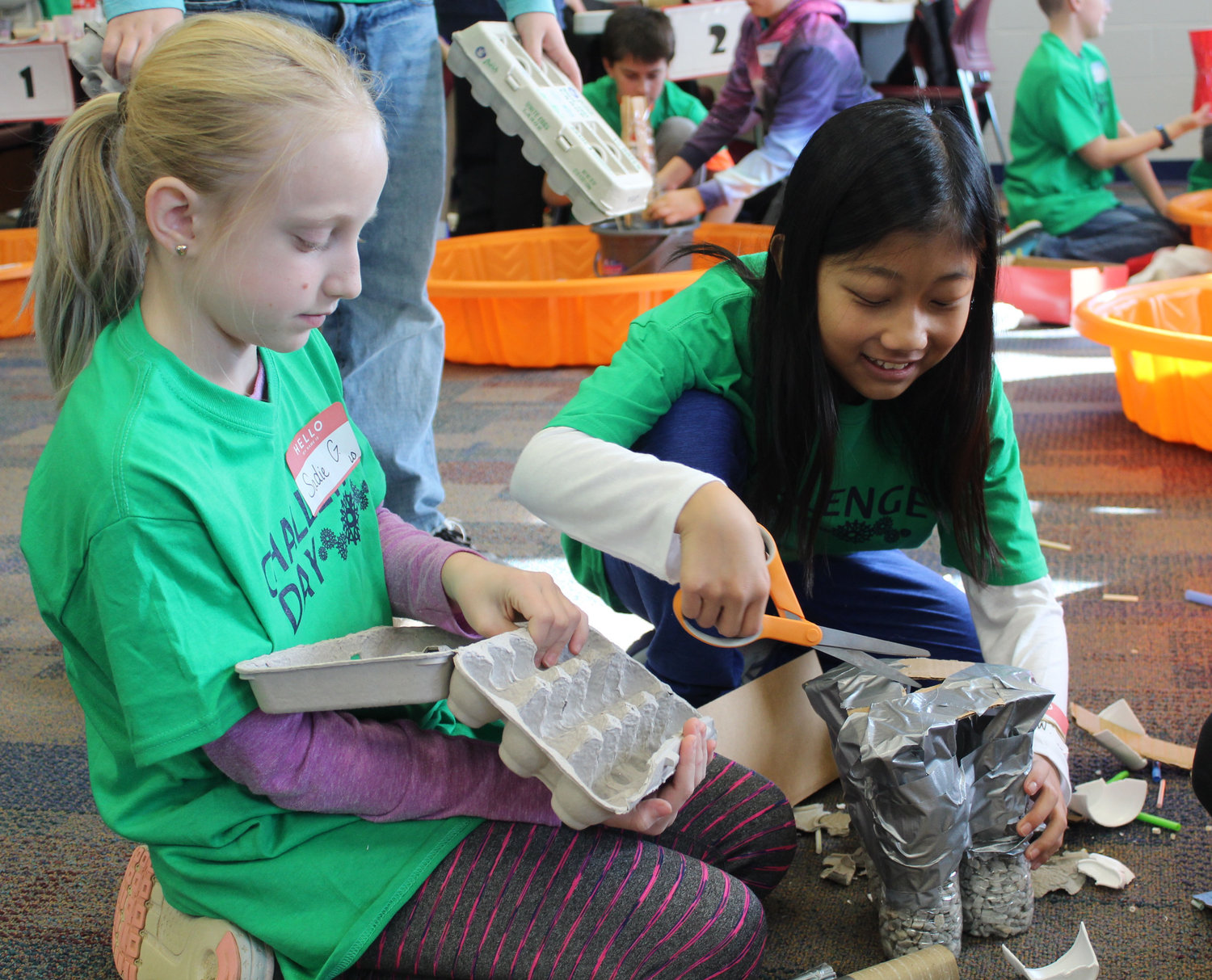 Lower Dauphin's Sadie Giampetro and Derry Township's Anna Wang work on their tower at the Challenge Day on Nov. 29. Gifted students from four area school districts were challenged to focus on foundation and build a tower that could withstand wind, an earthquake and weight.