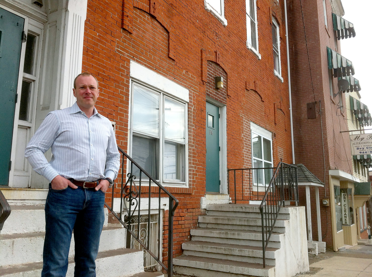 In this March 2015 file photo, George Crist stands in front of the building in the 100 block of South Union Street that he bought in 2014.