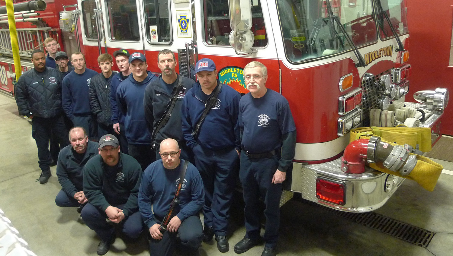 Members of Middletown Volunteer Fire Company pose in front of Engine 88 at the fire station on Adelia Street during a break from a Thursday night training session. The bronze decal that signifies 50 percent or more of the company achieving Firefighter 1 certification surrounds the blue Keystone that appears on Engine 88 that the company received from the Office of the State Fire Commissioner.