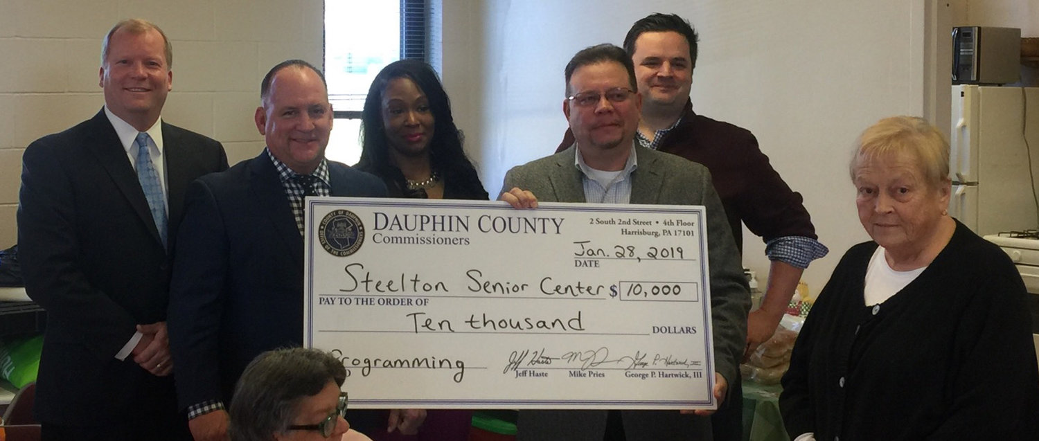 County Commissioners Mike Pries and George Hartwick, III, Steelton Borough Councilwoman Keontay Hodge, Commissioner Jeff Haste, Steelton Borough Manager Doug Brown, and Steelton Senior Center Director Barb Coates attend a presentation at the center Jan. 28.
